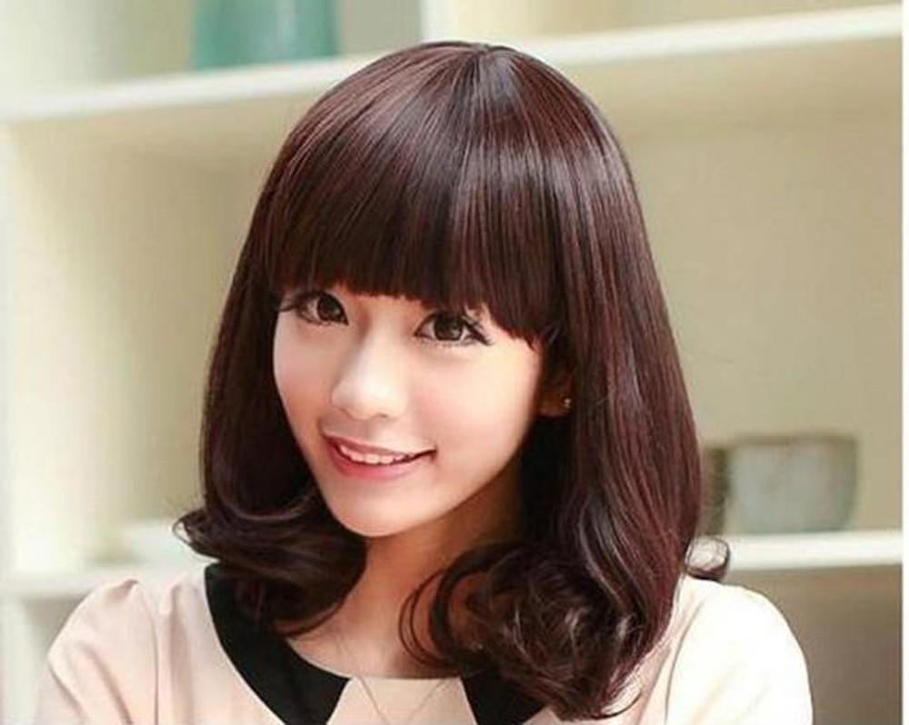 Kiểu tóc ngắn uốn cụp cho mặt dài