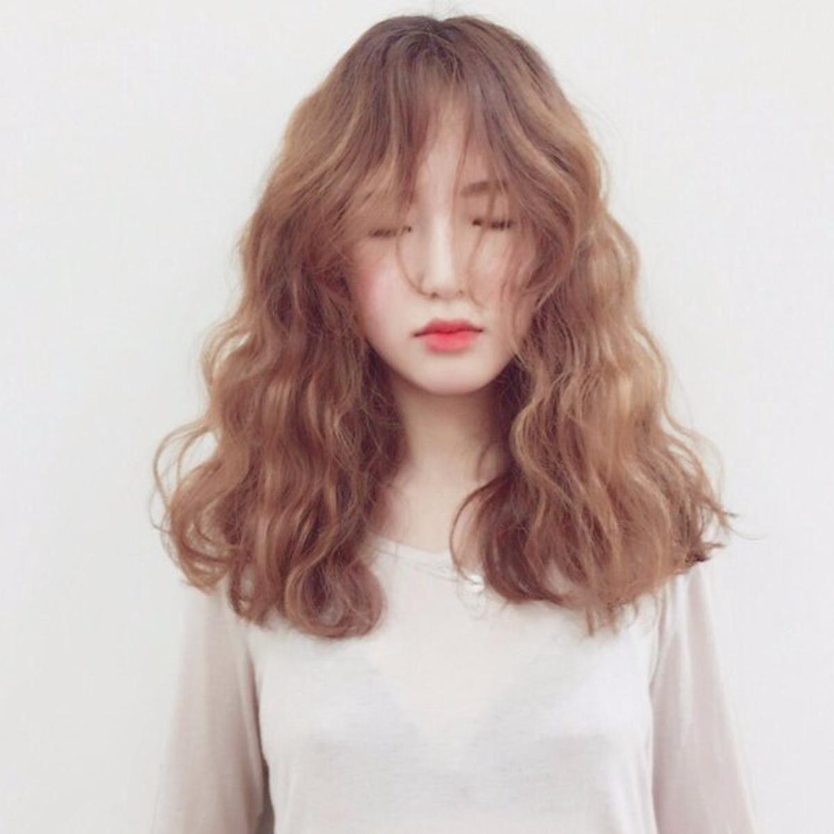 Kiểu tóc xoăn lọn buộc đẹp nhất
