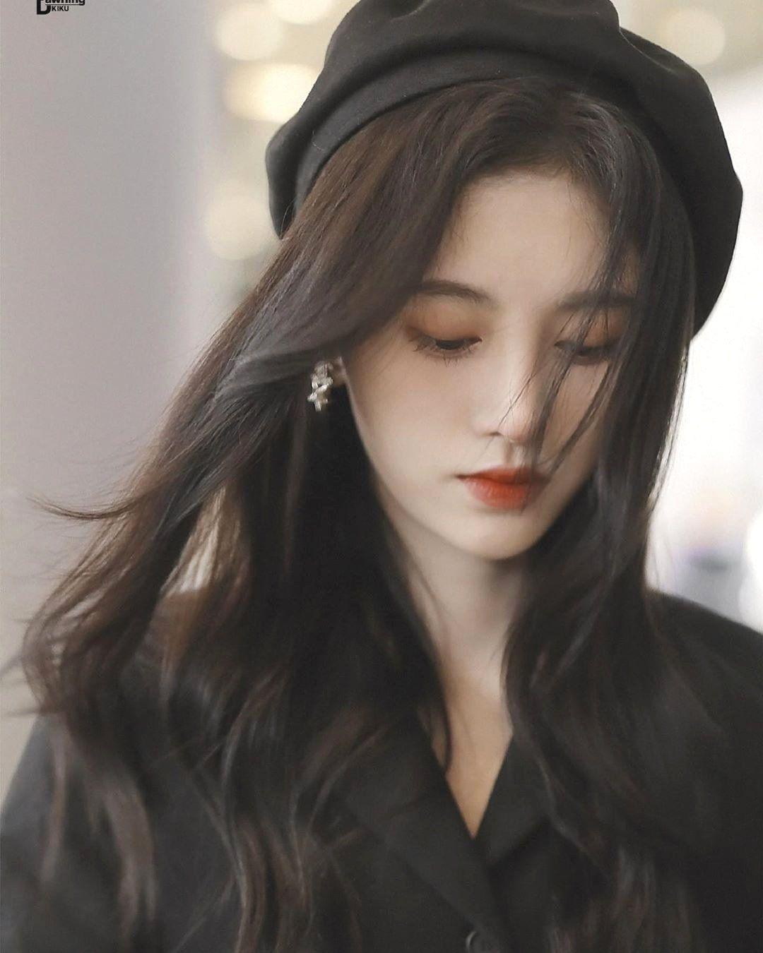 Kiểu tóc dài uốn không mái đẹp nhất