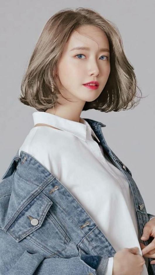Kiểu tóc nữ uốn cụp xoăn mái đẹp nhất