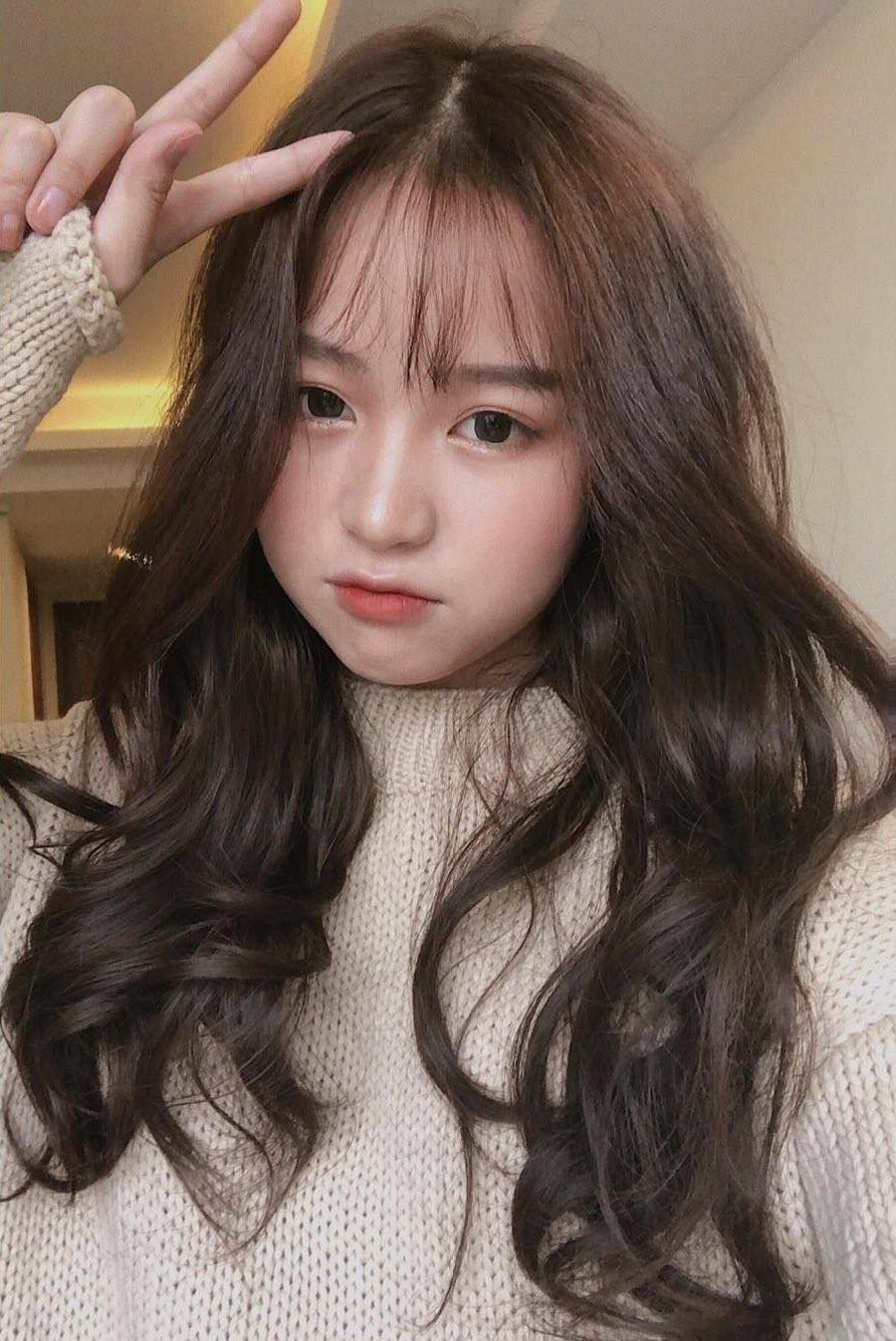Kiểu tóc xoăn dài dễ thương nhất
