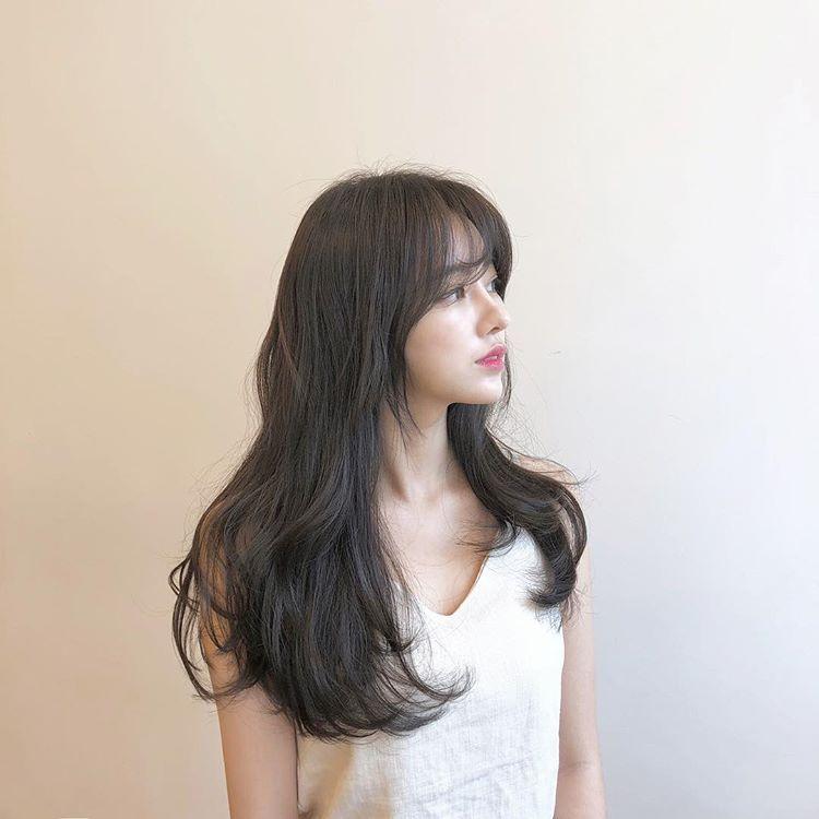 Mẫu tóc dài uốn cúp đuôi
