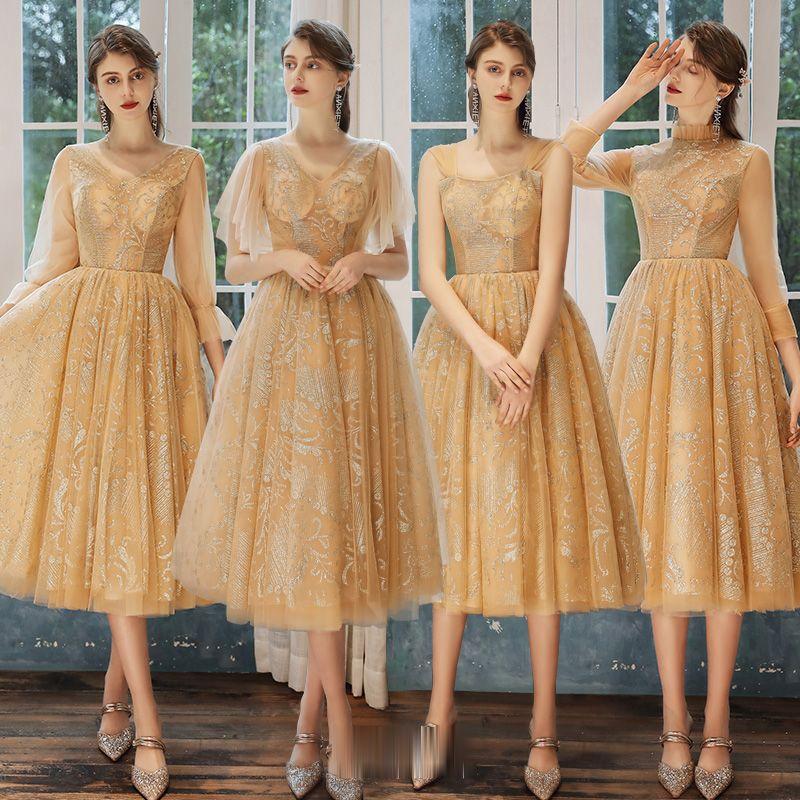 Mẫu váy phù dâu tone vàng nhẹ